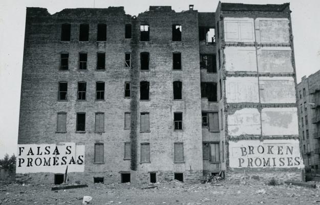 Urban decay. Falsas Promesas Broken Promises, John Fekner, Charlotte Street Stencils, South Bronx, NY 1980. John Fekner CC BY-SA 3.0